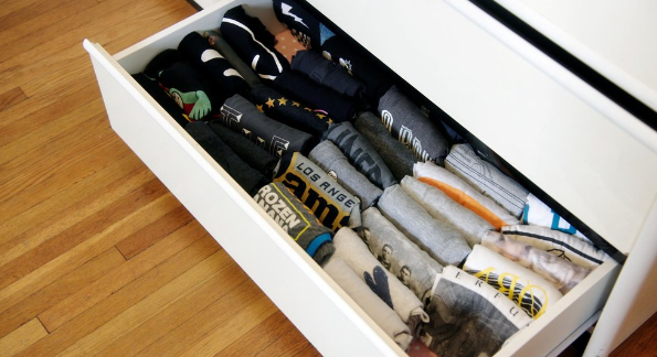 A drawer of shirts neatly folded according to the KonMari method.
